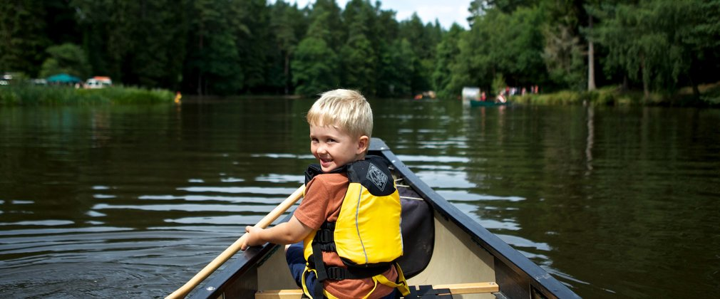boy enjoying kayaking on the river