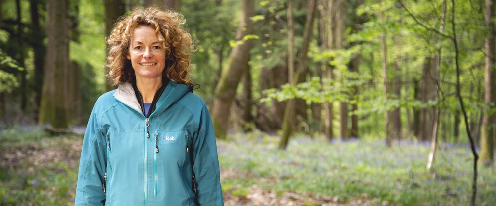 Kate Humble against a bluebell woodland backdrop