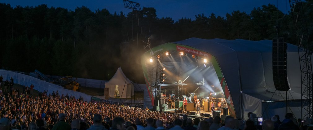 Paul Weller performing on stage at Cannock Chase