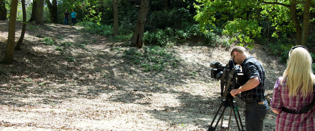 Crew filming in the forest
