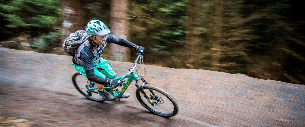 Mountain biker racing in Hamsterley Forest