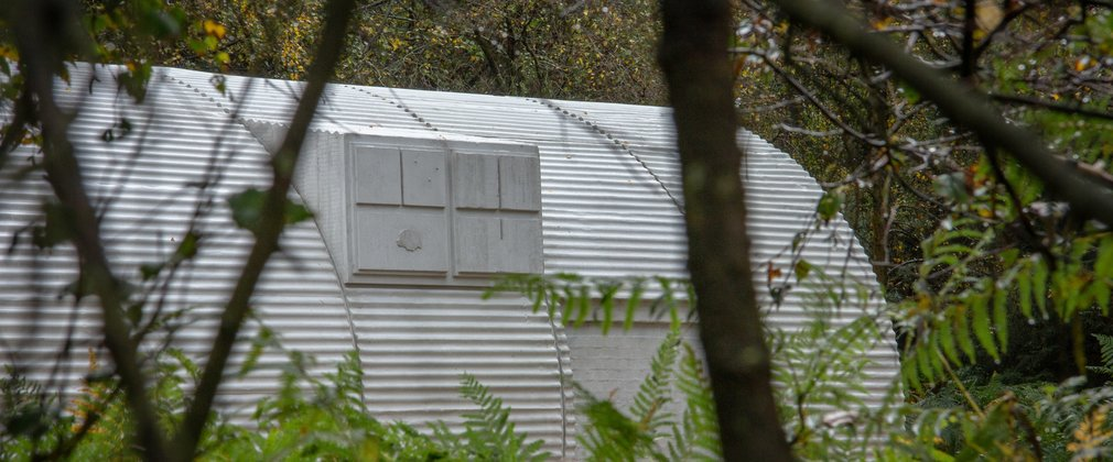 Nissen Hut sculpture through the trees