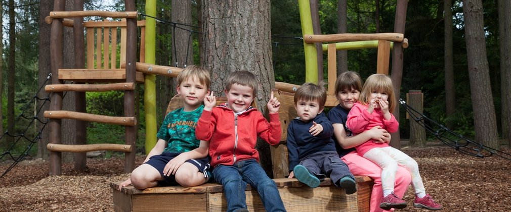 Children playing in the Timberline play area at Alice Holt Forest