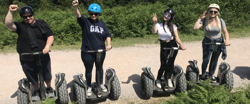 family enjoying a segway adventure in the forest