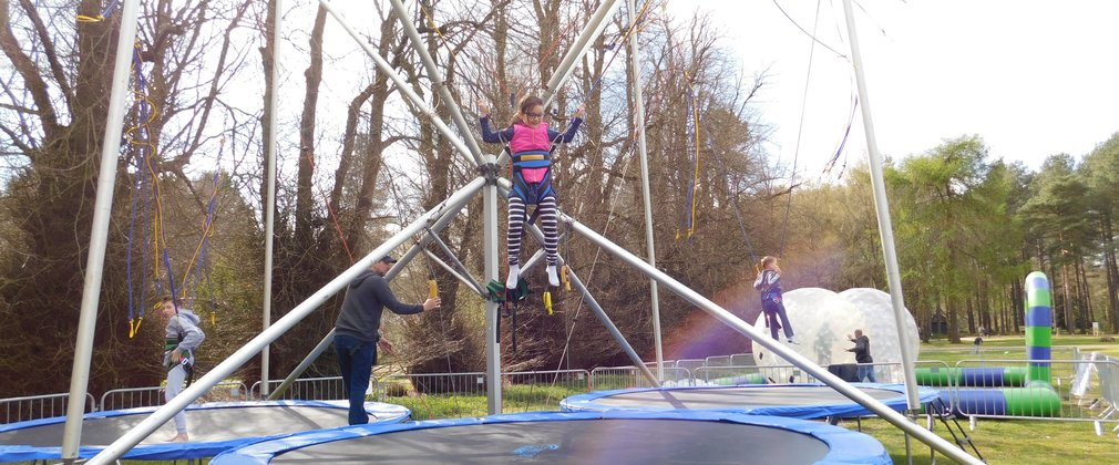 Child jumping on trampoline