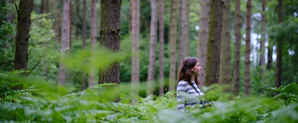 Tiffany Francis stood in waste high forest greenery