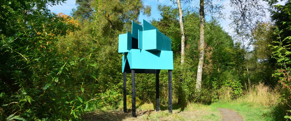 Blue sculpture in forest