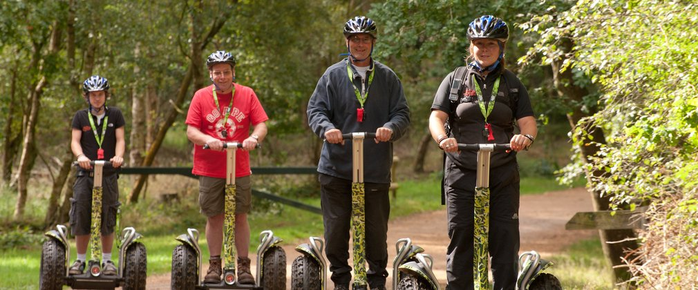 Segway users on a forest trail