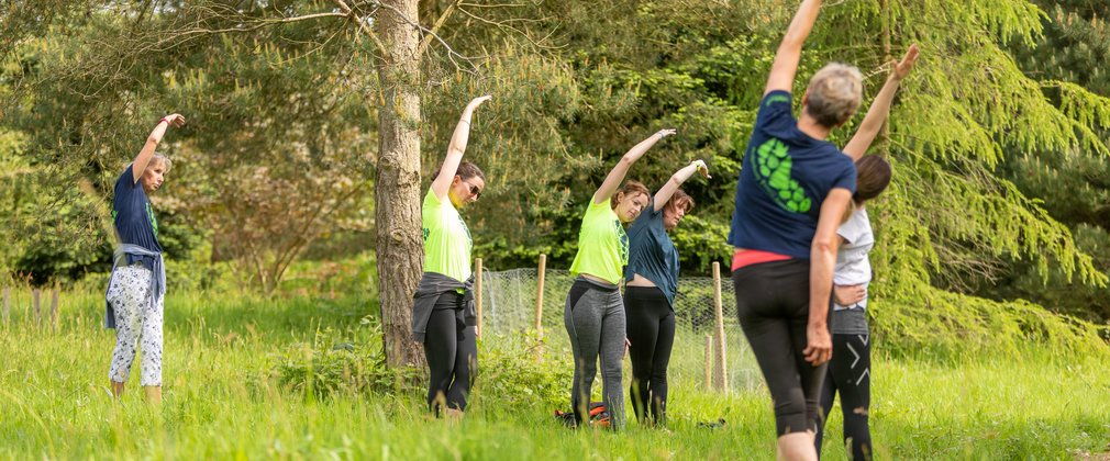 Bedgebury Forest Runners stretching in spring