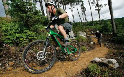 adults on mountain biking trail
