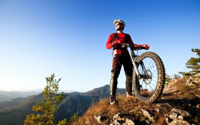 Mountain biker at the top of a forest trail