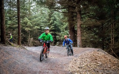 children cycling on family friendly trail