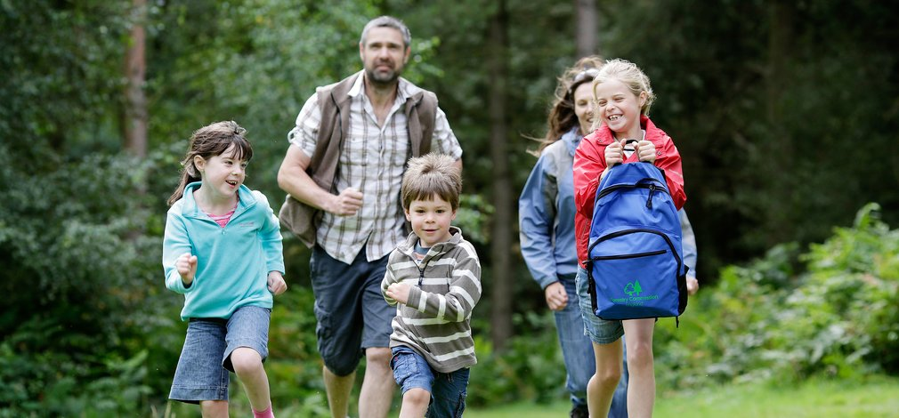 Family walking on a woodland trail