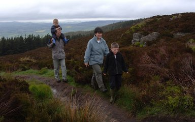 Family walking at Simonside, near Rothbury