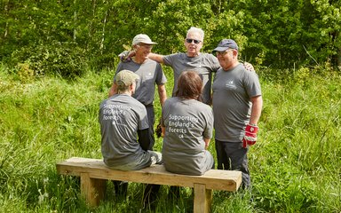 Volunteering group sat on a bench