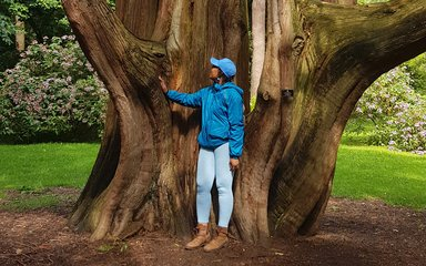 Zakiya Mckenzie stood by large tree