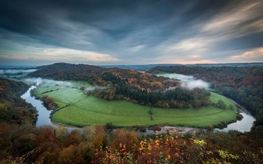 Sunrise over Symonds Yat with mist in the valley