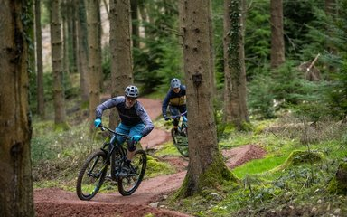 Two riders on cycling trail in the Forest of Dean