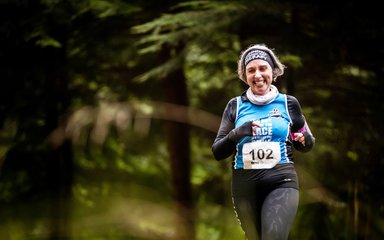 Female trail runner in forest