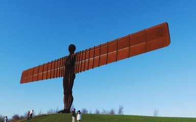 The Angel of the North sculpture with blue skies