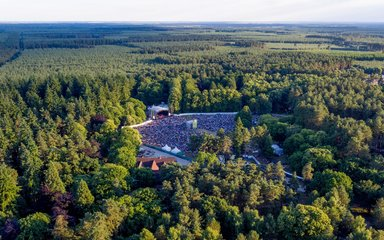 Aerial view concert outdoors in a forest