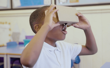 Schoolchild viewing Google Expeditions using a cardboard viewer