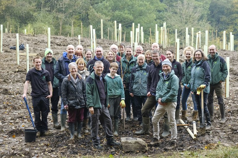 Group of Forestry England staff stood smiling at tree planting event